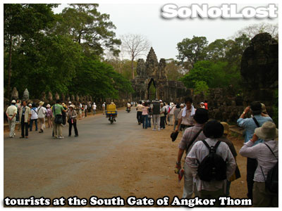 tourists at the South Gate of Angkor Thom