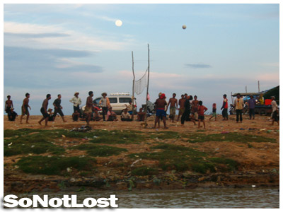Khmer locals playing volleyball by Tonle Sap