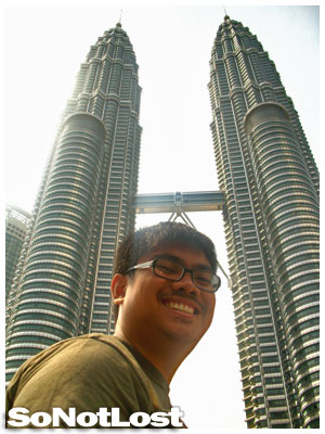 dwarfed by the Petronas Towers