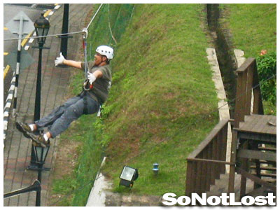 finally letting go of the cable at the flying fox in KL Tower